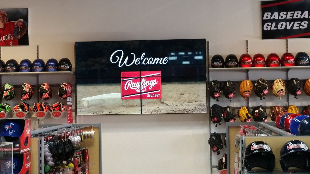 Digital Video Wall Impact and attracting customers showing videos covering multiple screens at Rawlings located in Home Run Sports, Mississauga